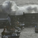 Large waves hit the seafront at the Cobb in Lyme Regis, south west England